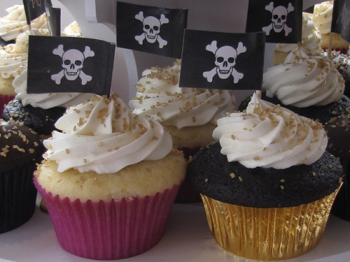"We made cupcake flags (like these pirate flags) with various messages for the event. I said, ""Choose a cupcake that speaks to you."""